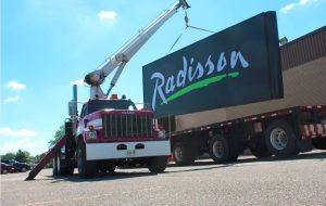 Image of Feren crane holding Large Radisson Sign|Niagara Sign Installation